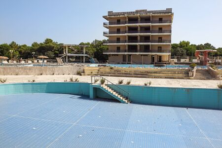 A swimming pool of the abandoned resort empties and damage