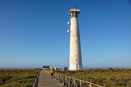 Lighthouse on Morro Jable beach on Jandia peninsula in sunrise light, Fuerteventura, Canary Islands, Spain Stock Photo