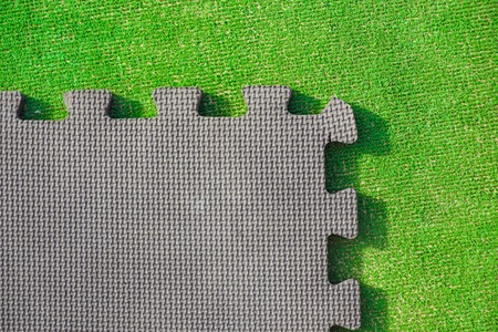 Jigsaw puzzle pieces on bright green background, horizontal view Stock Photo
