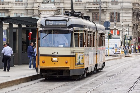 MILAN, ITALY - APRIL 11, 2015: Vintage orange tram ATM Class 1500 on the street of Milan, Italy Editorial