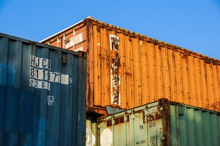 Milan , Italy - March, 19, 2018: cargo containers stacked in port. Container port or terminal. Freight, shipping, delivery, logistics, merchandise. Storage, warehouse, trade, customs.