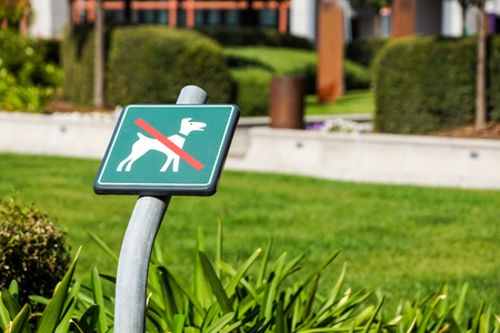 No Dogs Allowed On The Grass Area Sign Stock Photo