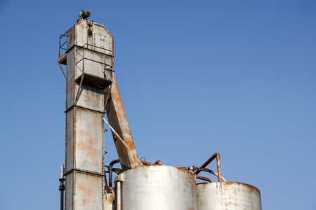 old rustic iron silo at old industrial farm Stock Photo