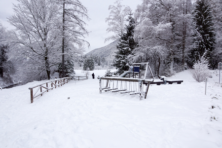 Childrens playground covered with snow in winter