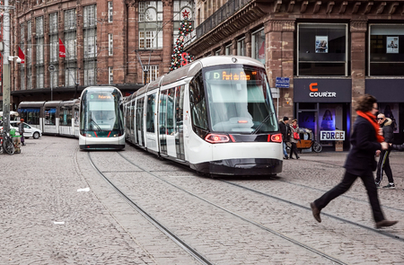 Strasbourg, France - December 28, 2017 : electric tram train of the Strasbourg public transport company (CTS) running on a street in the city on a winter day