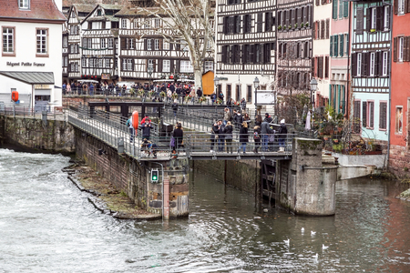 STRASBOURG, FRANCE - december 23 , 2017: People Tourists viewing from elevator boats place called Petite-France in Strasbourg. Petite-France is an historic area in the center of Strasbourg . Editorial