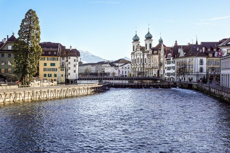 LUCERNE, SWITZERLAND - december 2, 2017: Historic center of Lucerne with view of the dam and bridge on river Reuss. Old Swiss houses