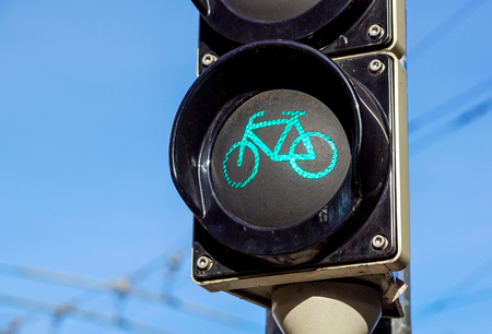 Detail shot with a bicycle traffic light switched to green colour