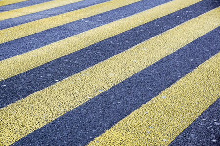Level asphalted road with a dividing yellow stripes. Stockfoto