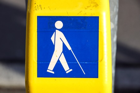 Symbol for disabled person at the traffic light . button for blind people Imagens