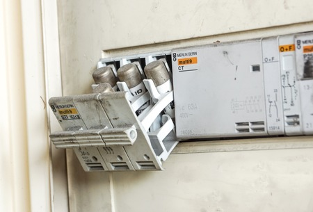 Milan , Italy - June 30, 2018: Electricity main center and old electrical fuse box with porcelain fuses