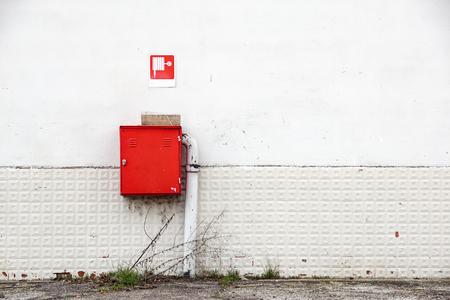 an fire hose hanging on the wall Stock Photo