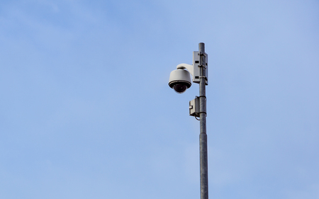 outdoor video surveillance camera , dome security camera on the street.