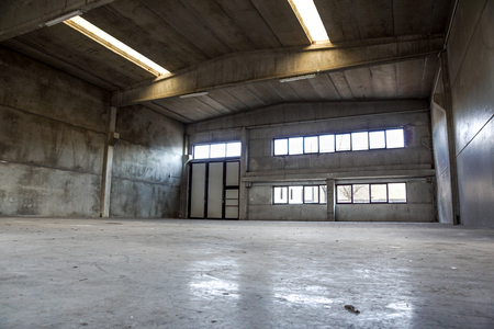 Interior of old factory buildings abandoned and empty Stock Photo