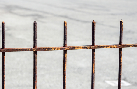 Close-up of a forged iron fence with arrows