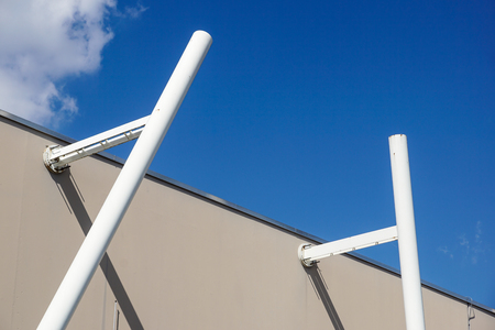 metal structure with a ladder on a background of blue sky Imagens