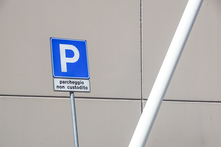 road sign parking . written in Italian which means : unattended parking