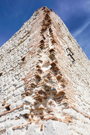 ruins of old medieval castle . fortified wall and tower detail brick Stock fotó