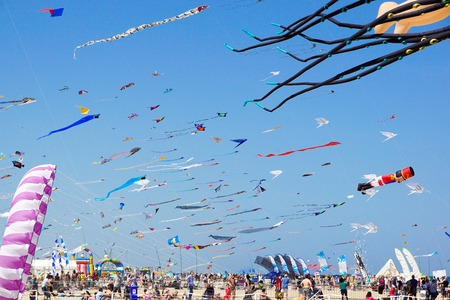 CERVIA, ITALY - MAY 1: Sky full of kites for International Kite Festival on May 1, 2010 in Cervia, Italy. This Festival brings together kite flyers from all over the world every year since 1981. Editorial