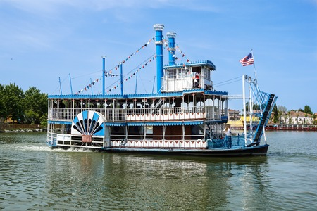 Vintage paddlwheel steamboat painted in old-fashioned American in the river