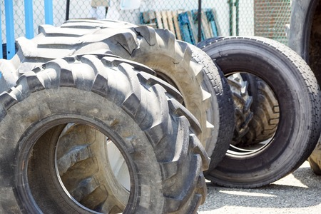 Wide shot of pile of old tractor tires. Can be use for decoration and refer to high intensity training or cross fit training. Reklamní fotografie