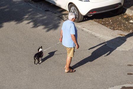 New York, USA - 3 January ,2019. Man walking with a dog at the street of NYC. Lifestyle. Editöryel
