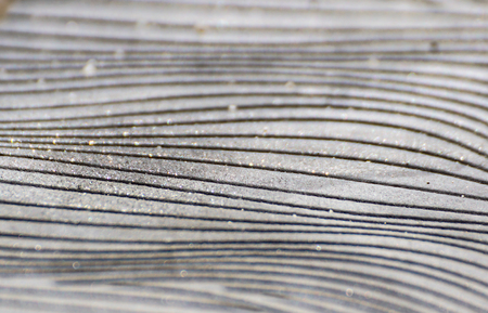 abstract curved lines formed by tar on a road Stock Photo
