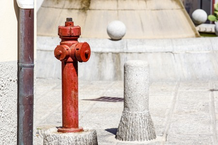 Red hydrant on the city street . Detail Banco de Imagens - 122114026