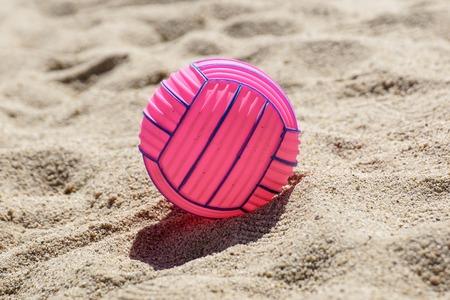 beach volleyball ball at the beach .Pink ball