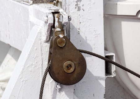 Pulley and rope on a boat. Small detail.