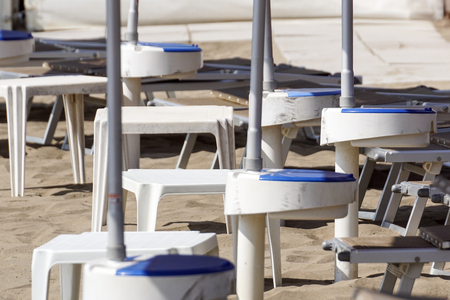 small tables of a beach umbrella without people