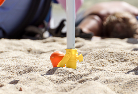 Support for beach umbrella. beach umbrella screw Banco de Imagens - 122114207