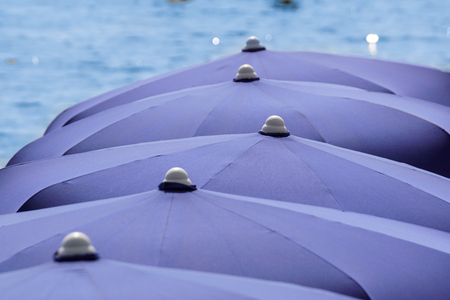 Beach umbrella on a sunny day, sea in background Banco de Imagens - 122114228