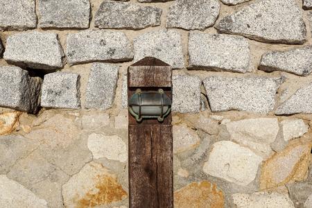 small wooden pedestrian lamp post View along the wooden boardwalk