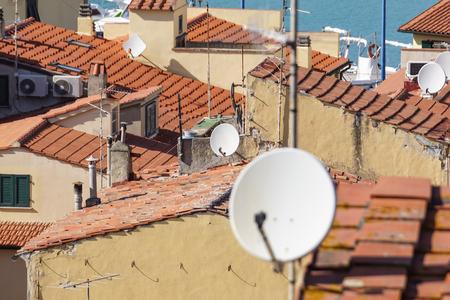 Home TV antennas mounted on a roof. Banco de Imagens