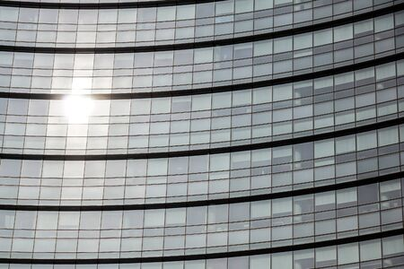 Conceptual image of textured window facade of modern design skyscraper office buildings in city business district, reflection in window surface pattern background . Banco de Imagens - 125478389