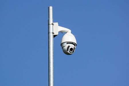 Security camera that sees 360 on light pole .