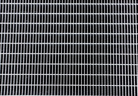 metal grid background on pavement on the street