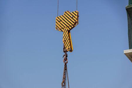 Closeup view of crane hook against blue sky . Reklamní fotografie