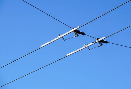 Electric streetcar wires overhead Trolley, Trams. Blue sky . 스톡 콘텐츠