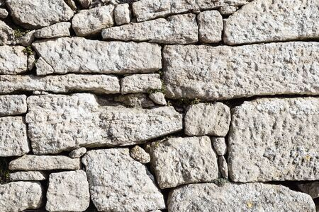 Background of stone wall texture .stone wall . Banco de Imagens