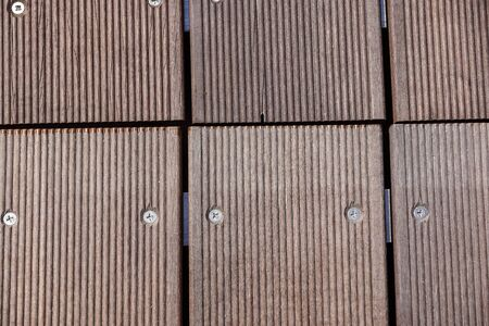 Unusual garden path made as massage road for feet. Part of that walkway made of wooden cubes. Closeup. Selective focus