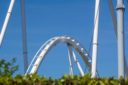 close up of rollercoaster track curving down Banco de Imagens