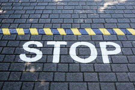Stop written on floor asphalt concept image Archivio Fotografico