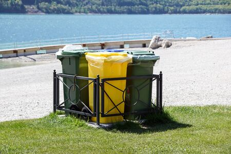 Different Colored Bins For Collection Of Recycle Materials -
