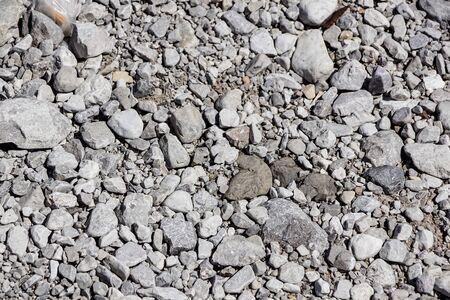 white pebble on the floor . stones texture