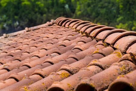 Closeup of the red clay roof tiles. selective focus .