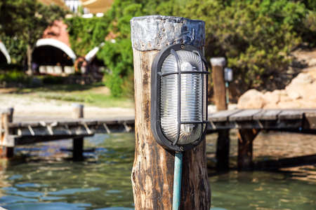 Lamp light with Illumination on the concrete floor for lighting on pier and fishing boat, ferry, yacht