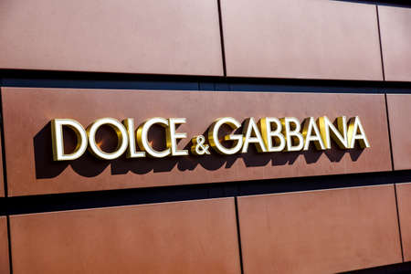 Florence,ITALY -December 8, 2011: Dolce Gabbana Florence Store Logo Italy mounted on the marble wall of Dolce Gabbana Store at Via de Tornabuoni,the heart of Florence high-class shopping district Editoriali