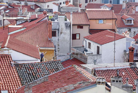 Roofs . View of the tiled roof tops and scenic skyline of the Old Town of Dubrovnik, taken from on top of its surrounding wall,